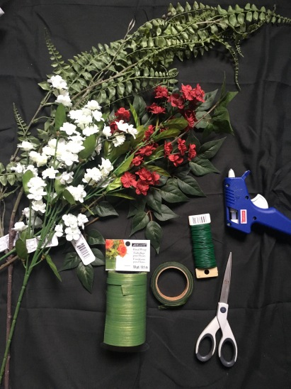 Supplies: Faux flowers, floral tape, floral wrap, scissors, hot glue gun, floral wire
